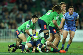 Fumiaki Tanaka of the Highlanders looks to offload the ball during the Super Rugby round 15 match between the Force and the Highlanders in Perth.