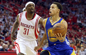 Golden State Warriors guard Stephen Curry (30) drives to the basket past Houston Rockets guard Jason Terry (31) during the game in game three of the Western Conference Finals May 23 in Houston.