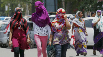 Allahabad: Girls cover their faces to beat the heat on a hot day in Allahabad on Friday. (Source: PTI)