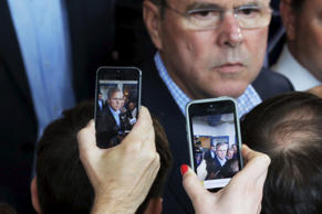 Reporters use their mobile phones to record potential 2016 Republican presidential candidate and former Florida Governor Jeb Bush as he answers questions after speaking at a business roundtable in Portsmouth, NH May 20, 2015.