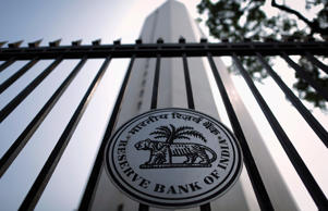 File: The Reserve Bank of India (RBI) seal is pictured on a gate outside the RBI headquarters in Mumbai October 29, 2013.