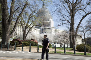 Police guard the U.S. Capitol grounds after a shooting took place, in Washington, April 11, 2015.