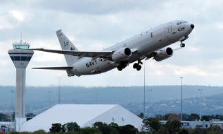 A U.S. Navy P-8 Poseidon aircraft takes off from Perth International Airport in this April 16, 2014.