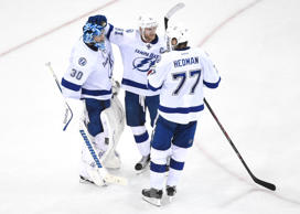 Tampa Bay Lightning goalie Ben Bishop (30), center Steven Stamkos (91) and defenseman Victor Hedman (77) celebrate a win against the New York Rangers game five of the Eastern Conference Final of the 2015 Stanley Cup Playoffs at Madison Square Garden. The Lightning defeated the Rangers, 2-0.
