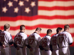 File photo of Baltimore Orioles baseball players lined up for the National Anthem.