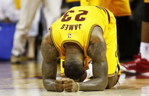 LeBron James of the Cleveland Cavaliers reacts after their 114-111 win over the Atlanta Hawks in overtime during Game 3 of the Eastern Conference finals at Quicken Loans Arena on May 24, 2015, in Cleveland.