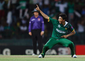 Pakistan's Raza Hasan celebrates after taking the wicket of Australia's Glenn Maxwell during their Twenty20 World Cup Super 8 cricket match in Colombo October 2, 2012.