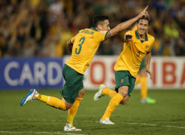 A file image of Australia's Jason Davidson, left, celebrating with team mate Mark Milligan after scoring a goal during the AFC Asian Cup semifinal soccer match between Australia and United Arab Emirates in Newcastle, Australia.