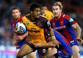 Anthony Milford of the Broncos is tackled during the round 11 NRL match between the Newcastle Knights and the Brisbane Broncos at Hunter Stadium on May 25, 2015 in Newcastle, Australia.