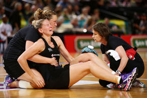 Casey Kopua of the Ferns is assisted by medical staff after sustaining a serious injury during the International Netball Test match between the New Zealand Silver Ferns and the Australian Diamonds at Allphones Arena on October 11, 2014 in Sydney, Australia.