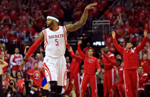 May 25, 2015; Houston, TX, USA; Houston Rockets forward Josh Smith reacts after scoring against the Golden State Warriors during the first quarter in game four of the Western Conference Finals of the NBA Playoffs. at Toyota Center.