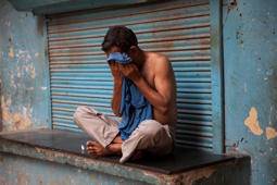 File: An Indian man wipes sweat off his face on a hot summer day in New Delhi, India, Sunday, May 24, 2015. Heat wave has tightened its grip over most parts of the country. More than 200 people have died since mid-April in a heat wave sweeping two southeast Indian states, Andhra Pradesh and Telangana, officials said Saturday.