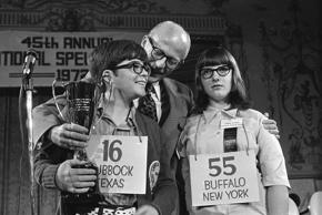 FILE - In this June 8, 1972, file photo, Robin Kral, 14,  of Lubbock, Texas, left, holds his trophy after winning the 1972 National Spelling Bee in Washington. He out-spelled Lauren Pringle, 13, right, of Buffalo, N.Y., to win the title. (