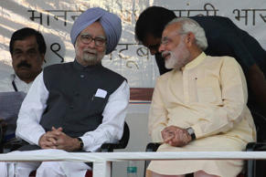 File: Indian Prime Minister Manmohan Singh, second left, and Gujarat state chief Minister Narendra Modi, right, interact during the inauguration of the renovated memorial of Sardar Vallabhbhai Patel, one of the founding fathers of the Indian republic, in Ahmadabad, India, Tuesday, Oct. 29, 2013. Modi is the opposition Bharatiya Janata Party's (BJP) prime ministerial candidate for the 2014 general elections.