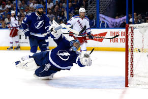 Ben Bishop #30 of the Tampa Bay Lightning gives up a goal to Derick Brassard #16 of the New York Rangers during the third period in Game Six of the Eastern Conference Finals during the 2015 NHL Stanley Cup Playoffs at Amalie Arena.