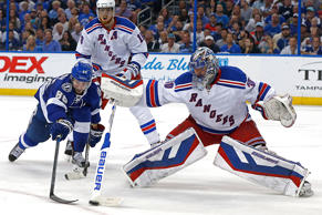 Henrik Lundqvist of the New York Rangers makes a stick save against Nikita Kucherov of the Tampa Bay Lightning during the second period in Game Six of the Eastern Conference Finals during the 2015 NHL Stanley Cup Playoffs at Amalie Arena on May 26 in Tampa,