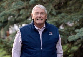 John Malone, the largest shareholder of Charter Communications.