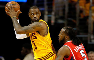 DeMarre Carroll #5 of the Atlanta Hawks defends LeBron James #23 of the Cleveland Cavaliers in the first quarter during Game Four of the Eastern Conference Finals of the 2015 NBA Playoffs at Quicken Loans Arena on May 26, 2015 in Cleveland.