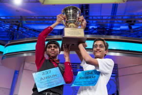 File photo of Ansun Sujoe, 13, of Fort Worth, Texas, left, and Sriram Hathwar, 14, of Painted Post, N.Y., raising the championship trophy after being named co-champions of the National Spelling Bee, on Thursday, May 29, 2014, in Oxon Hill, Md.