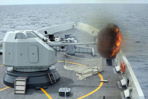 "In this photo released Sunday by China's Xinhua News Agency, an anti-surface gunnery is fired from China's Navy missile frigate Yulin during the ""Exercise Maritime Cooperation 2015"" by Singapore and Chinese navies in the South China Sea."