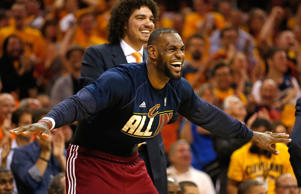 LeBron James and Anderson Varejao of the Cleveland Cavaliers react on the bench in the fourth quarter against the Atlanta Hawks during Game Four of the Eastern Conference Finals of the 2015 NBA Playoffs at Quicken Loans Arena on May 26, 2015 in Cleveland, Ohio.