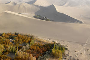 Aerial view of Crescent Lake and the giant sand dunes in the Gobi Desert, Silk Road, Dunhuang, in Gansu, China.
