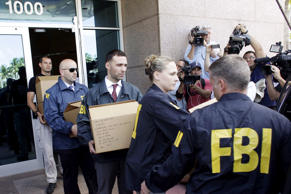 FBI agents bring out boxes after an operation inside the CONCACAF offices in Miami Beach, Florida May 27, 2015.
