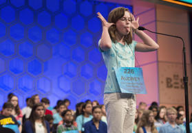"Audrey Frische of Soddy Daisy, Tennessee, makes a face after hearing her word, ""obnebulate,"" during the 3rd round of the 88th Annual Scripps National Spelling Bee at National Harbor in Oxon Hill, Maryland, May 27, 2015."