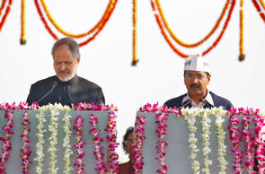 File: Najeeb Jung (L), Delhi's Lieutenant Governor, administers the oath to Arvind Kejriwal, leader of Aam Aadmi (Common Man) Party (AAP), as the new chief minister of Delhi during a swearing-in ceremony at Ramlila grounds in New Delhi December 28, 2013.