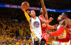 Stephen Curry of the Golden State Warriors goes up for a shot against the Houston Rockets in Game Five of the Western Conference Finals of the 2015 NBA Playoffs on May 27, 2015 at Oracle Arena in Oakland, Calif.