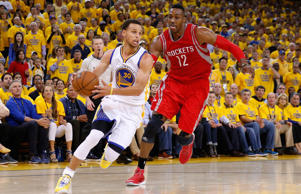 Stephen Curry of the Golden State Warriors drives on Dwight Howard of the Houston Rockets in the second half during game five of the Western Conference Finals of the 2015 NBA Playoffs at ORACLE Arena on May 27, 2015 in Oakland, Calif.