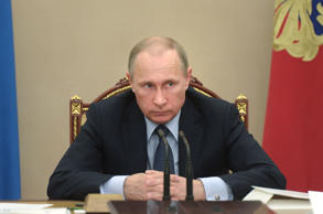 "In this Wednesday, May 27, 2015 pool photo Russian President Vladimir Putin listens during a meeting in the Kremlin, Moscow, Russia. Putin says the United States is meddling in FIFA's affairs in an attempt to take the 2018 World Cup away from his country. Putin said in televised comments Thursday, May 28, 2015, that it is ""odd"" that the probe was launched at the request of U.S. officials for crimes which do not involve its citizens and did not happen in the United States."
