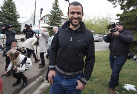 Omar Khadr leaves a news conference after being released on bail in Edmonton, Alberta, May 7, 2015.