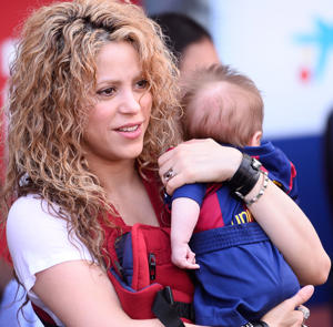 Shakira holds her son Sasha prior to a match in Spain.
