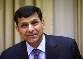 File: Reserve Bank of India (RBI) Governor Raghuram Rajan smiles after arriving for a quarterly interest rate review briefing at the RBI headquarters in Mumbai in this October 29, 2013 file photo.
