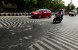 A road melt near Safdarjung Hospital after the temperature rose to 45 degrees celsius during hot weather as Delhi experienced yet another scorching day