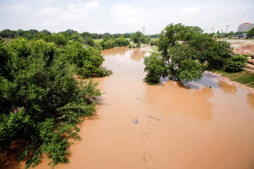 HOUSTON, TX - MAY 27:  Trees are submerged at Buffalo Bayou park after massive flooding May 27, 2015 in Houston, Texas. At least 19 people have been killed across Texas and Oklahoma after severe weather, including catastrophic flooding and tornadoes, struck over the past several days, with more rain expected. (Photo by Eric Kayne/Getty Images)