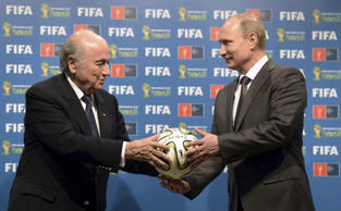 Russia's President Vladimir Putin, right, and FIFA President Sepp Blatter take part in the official handover ceremony for the 2018 World Cup scheduled to take place in Russia, in this file picture taken in Rio de Janeiro, Brazil, July 13, 2014.