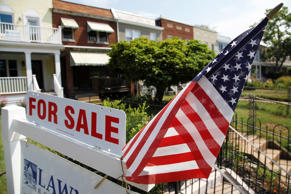 A U.S. flag decorates a for-sale sign at a home in the Capitol Hill neighborhood of Washington, DC in this August 21, 2012 file photograph. Home resales retreated in September from a two-year high, a reminder that America's housing sector is a long way from a full recovery despite recent signs of improvement. Existing home sales fell 1.7 percent last month to a seasonally adjusted annual rate of 4.75 million units, matching the median forecast in a Reuters poll, data from the National Association of Realtors showed on Friday.    REUTERS/Jonathan Ernst/Files     (UNITED STATES - Tags: BUSINESS REAL ESTATE)