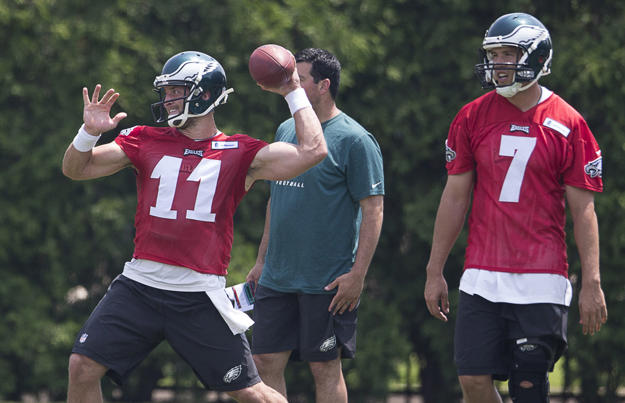 Tim Tebow #11 and Sam Bradford #7 of the Philadelphia Eagles participate in OTA's on May 28, 2015 at the NovaCare Complex in Philadelphia.