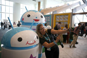 An attendee takes a selfie in front of Android mascots during the 2015 Google I/O conference on Thursday in San Francisco.