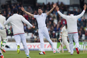 England's James Anderson, centre, celebrates his 400th test wicket after taking the wicket of New Zealand's Martin Guptill, caught by Ian Bell for 0 at Headingley cricket ground in Leeds, England, Friday, May 29, 2015.
