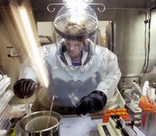 In this May 11, 2003, file photo, Microbiologist Ruth Bryan works with BG nerve agent simulant in Class III Glove Box in the Life Sciences Test Facility at Dugway Proving Ground, Utah. The specialized airtight enclosure is also used for hands-on work with anthrax and other deadly agents.