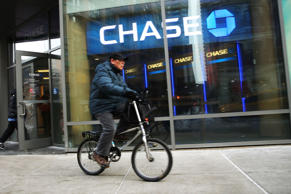 A man rides a bike past a Chase bank branch in Manhattan on February 24, 2015 in New York City.