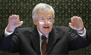 In this March 5, 2008, file photo, former U.S. House Speaker Dennis Hastert speaks to lawmakers on the Illinois House of Representatives floor at the state Capitol in Springfield, Ill.