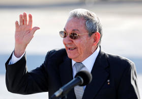 Cuba's President Raul Castro gestures as he speaks to reporters on the tarmac of the Jose Marti airport after escorting France's President Francois Hollande to his plane in Havana, Cuba, Tuesday, May 12, 2015.