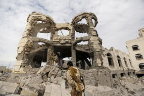 Houthi militants guard the house of Ali Haidar, a Houthi leader, destroyed by a Saudi-led air strike in Sanaa, Yemen, May 29, 2015.