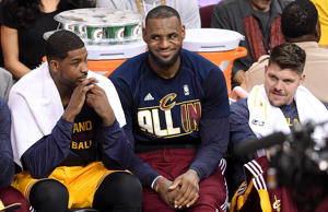 Tristan Thompson, LeBron James and Mike Miller of the Cleveland Cavaliers look on from the bench late in the second half against the Atlanta Hawks during Game Four of the Eastern Conference Finals of the 2015 NBA Playoffs May 26, 2015 in Cleveland.