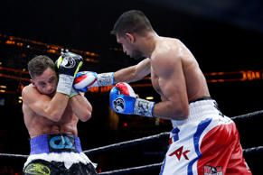 Chris Algieri, left, blocks a right from Amir Khan during the fifth round of a boxing bout, Friday, May 29, 2015, in New York