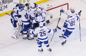 Lightning goalie Ben Bishop (30) is mobbed by his teammates after defeating the Rangers in game seven of the Eastern Conference Final of the 2015 Stanley Cup Playoffs at Madison Square Garden.